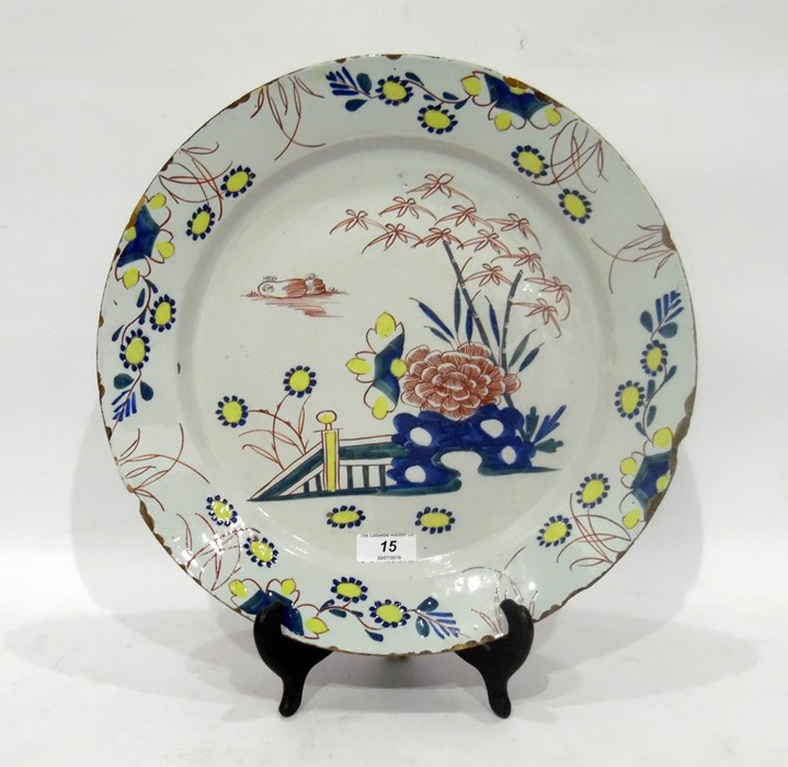 English delftware polychrome charger, circa 1750, probably London, painted with chrysanthemum and