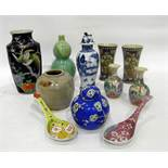 Group of Asian porcelain and stoneware, to include: a Chinese blue and white vase and a cover