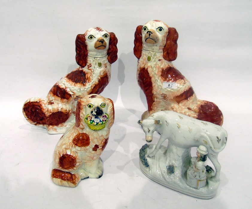 Pair Victorian Staffordshire spaniels with iron-red markings, anotherand a Victorian