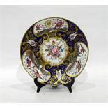 Late 18th/early 19th century porcelain plate centre painted with naturalistic floral bouquet, exotic