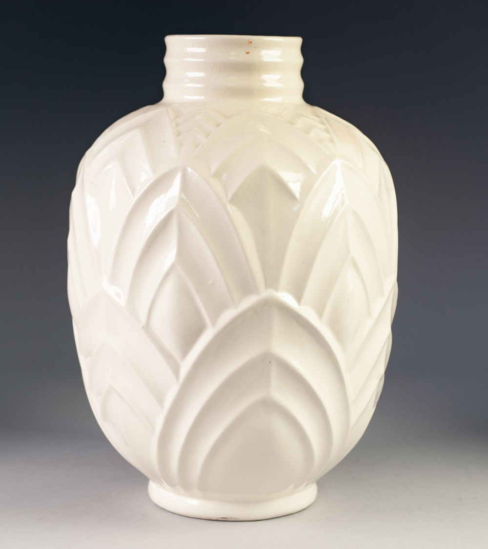 Lot 32 - BOCH FRERES WHITE GLAZED MOULDED ART DECO LARGE POTTERY VASE, of footed ovoid form with short ribbed