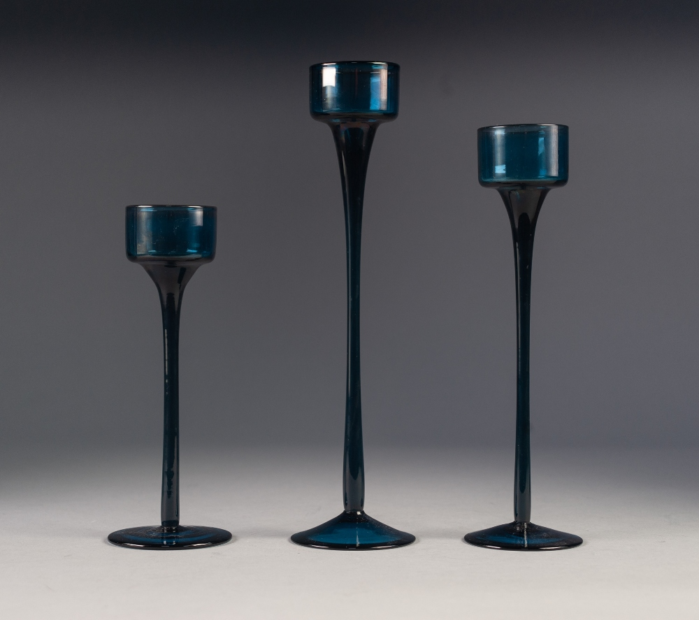 Lot 41 - RONALD STENNET WILLSON FOR WEDGWOOD, GRADUATED SET OF THREE BLUE 'SANDRINGHAM' GLASS CANDLESTICKS,
