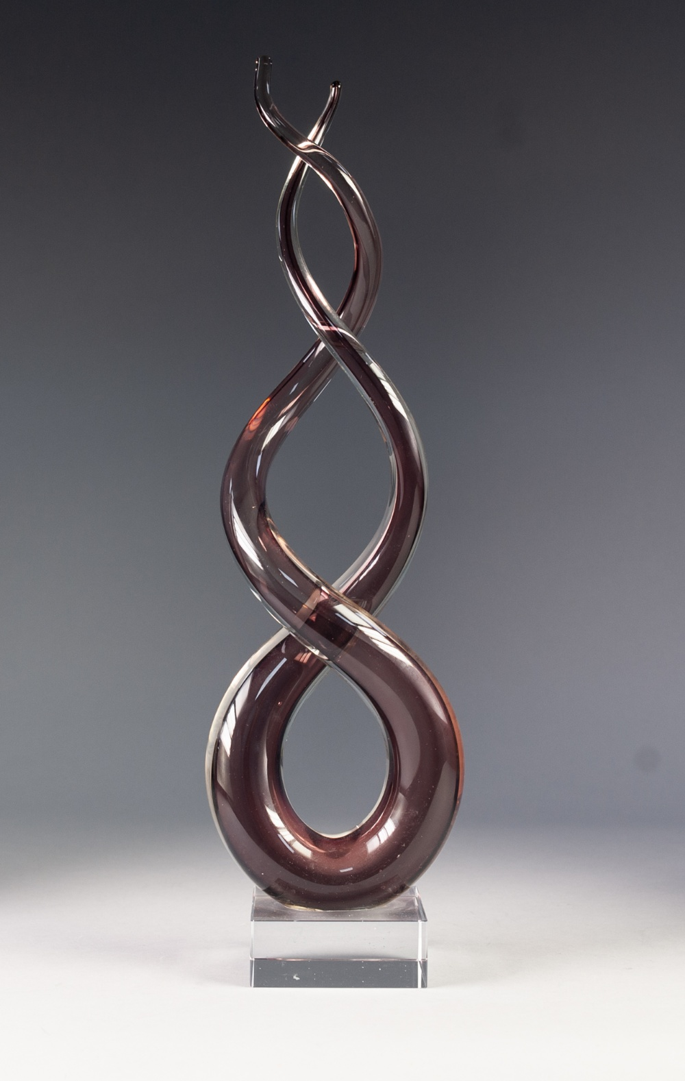 Lot 31 - MURANO PALE PINK CASED GLASS 'LOVE KNOT' SCULPTURE, raised on a clear glass oblong base, unmarked,