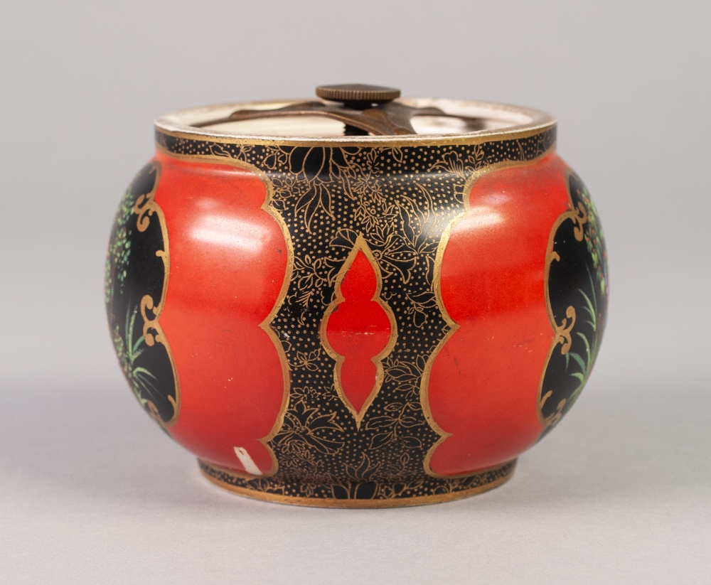 Lot 9 - A WILTSHAW AND ROBINSON CARLTON WARE POTTERY TOBACCO JAR with securing in place airtight cover,