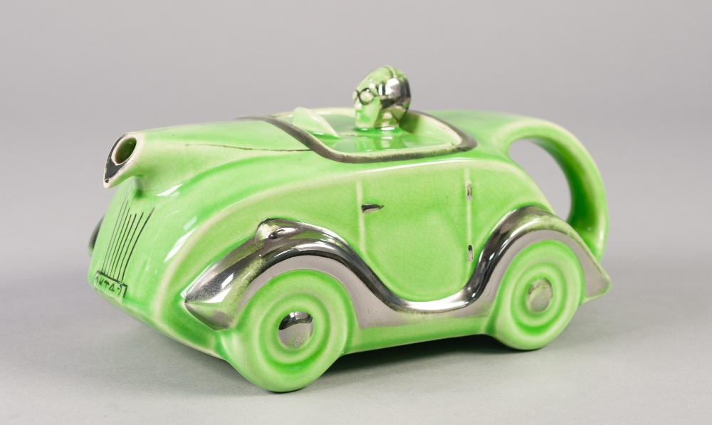 Lot 25 - SADLERS STYLE GREEN GLAZED RACING CAR PATTERN POTTERY TEAPOT, heightened in platinum lustre, 'MADE
