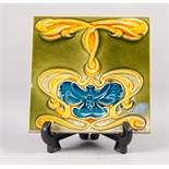 A SET OF NINE CIRCA 1900 CERAMIC TILES, decorated in the Art Nouveau taste, unmarked
