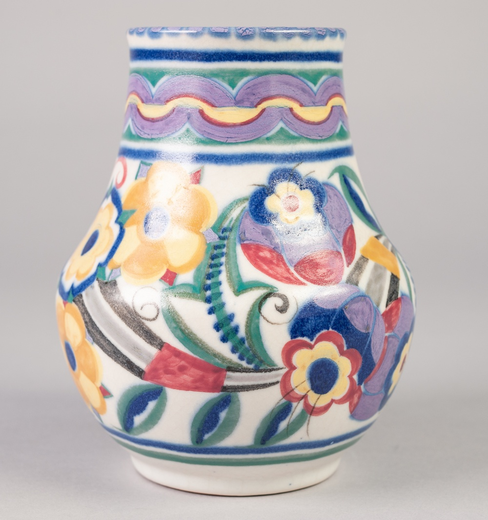 Lot 29 - A POST 1921 POOLE POTTERY BALUSTER SHAPE VASE, typically decorated in mauve, blue, pink, green and