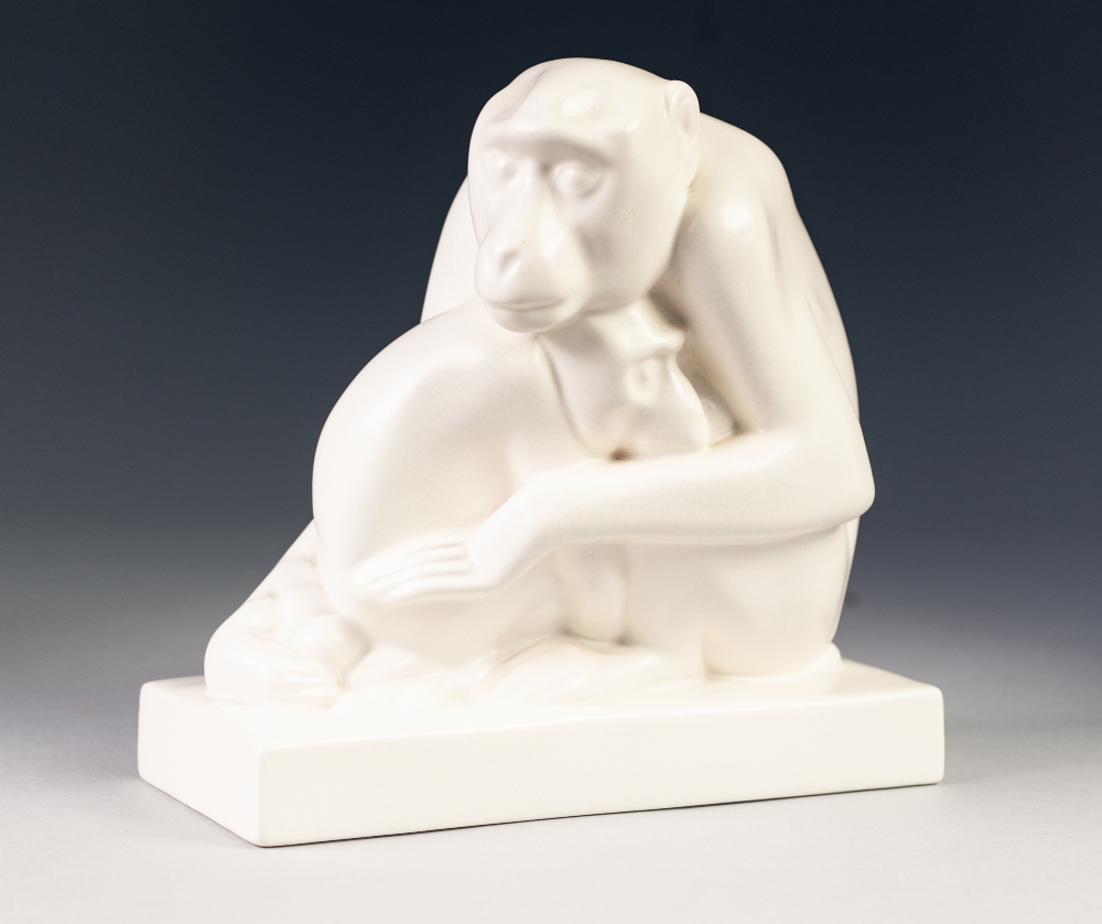 Lot 20 - A 1930's WEDGWOOD WHITE GLAZED MODEL by John Skeaping of an ape cradling its offspring, on a