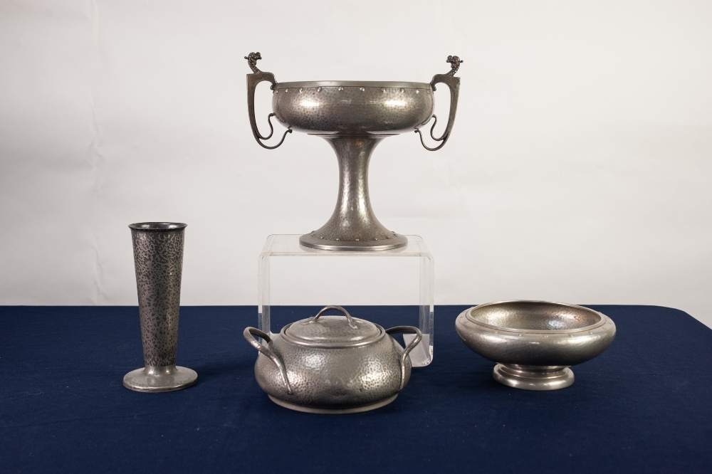 Lot 16 - FOUR ITEMS OF INTER WAR YEARS HAMMERED PEWTER COMPRISING; A PEDESTAL TWO HANDLED FRUIT BOWL, a low