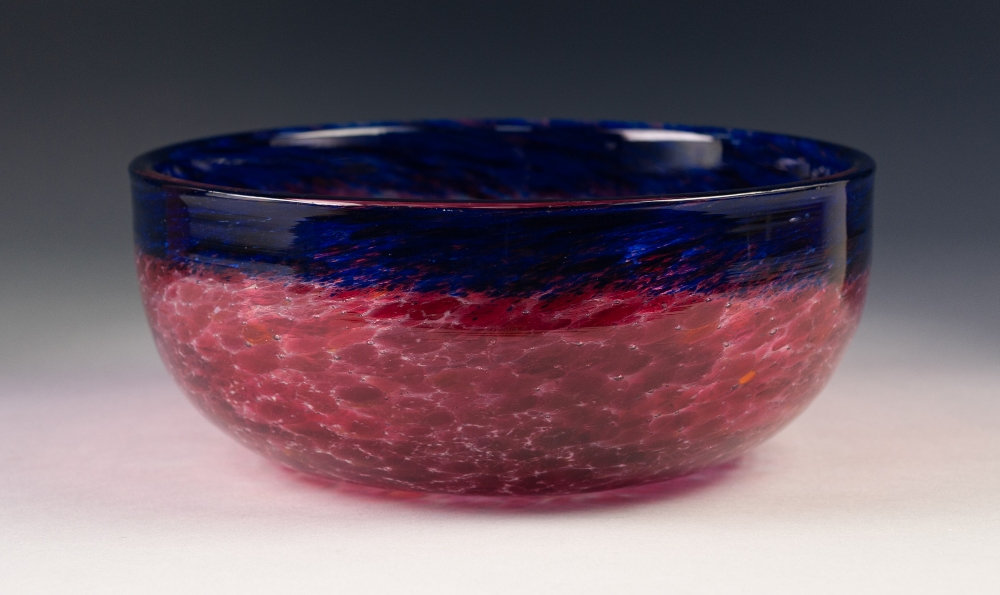 Lot 7 - PROBABLY 1930s MONART (PERTH, SCOTLAND) GLASS FRUIT BOWL, the clear glass stained with vibrant