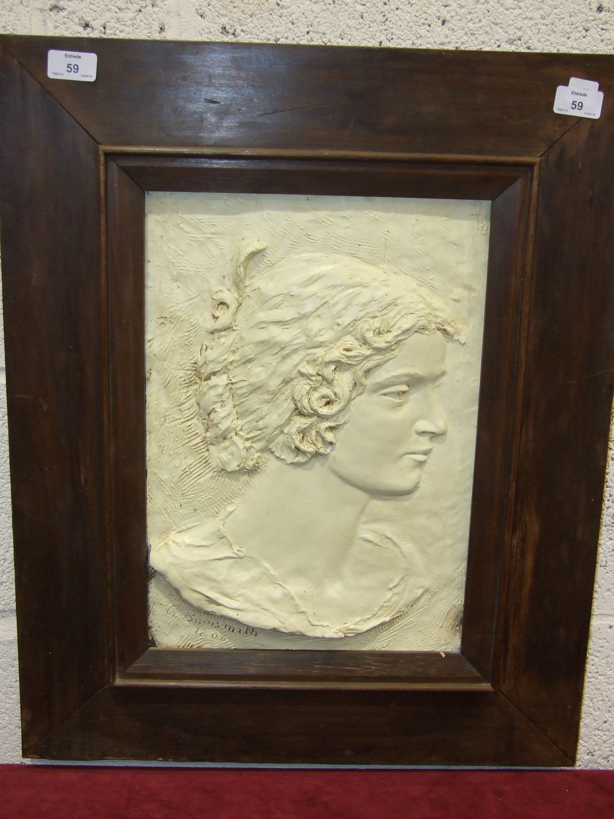 Lot 59 - G Barnsmith, a bronzed plaster plaque bust of a young woman, signed and dated, 1806, 39.5 x 28cm.