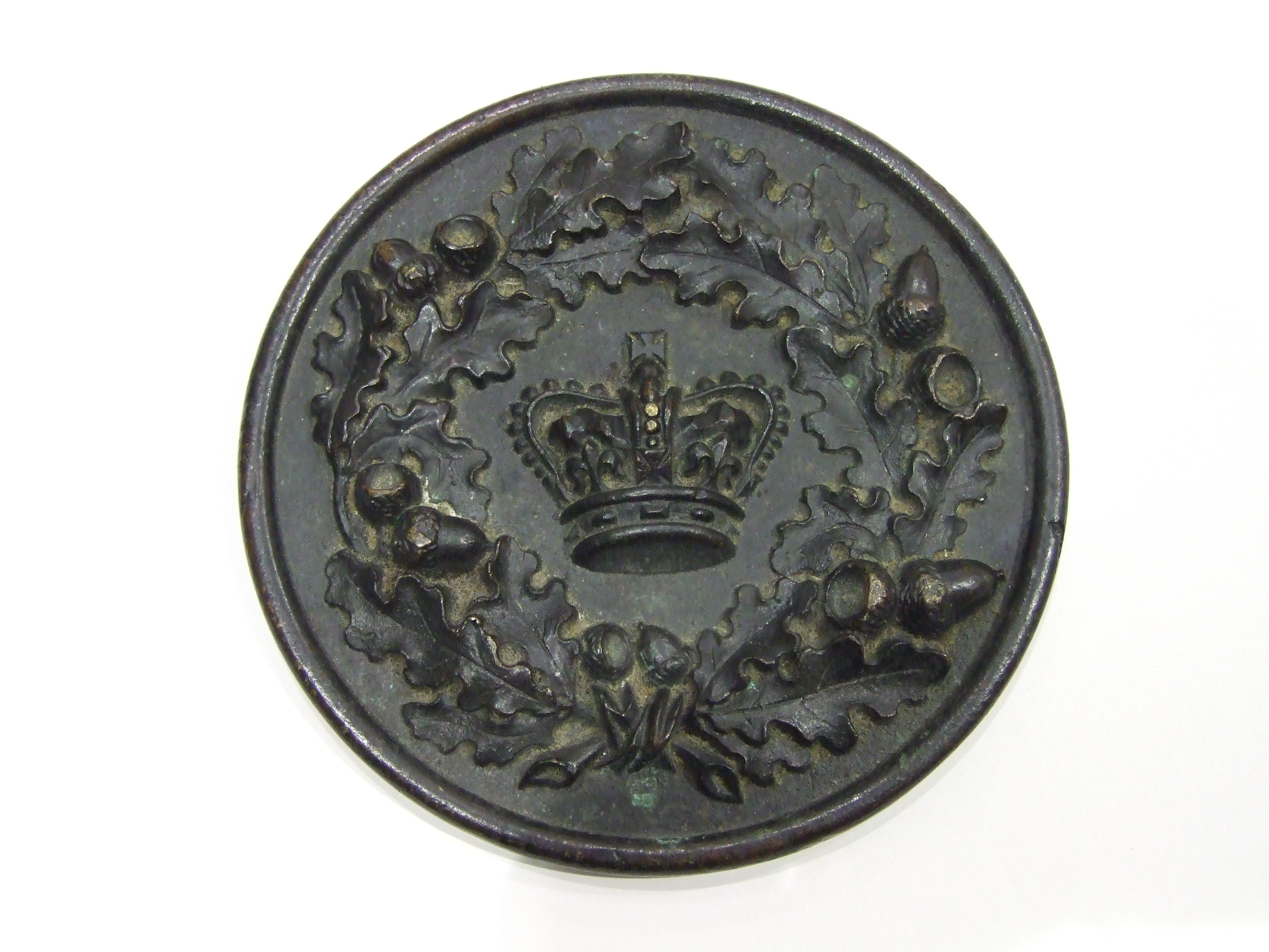 Lot 251 - A 19th/20th century circular bronze plaque with cast central crown surrounded by oak leaves and