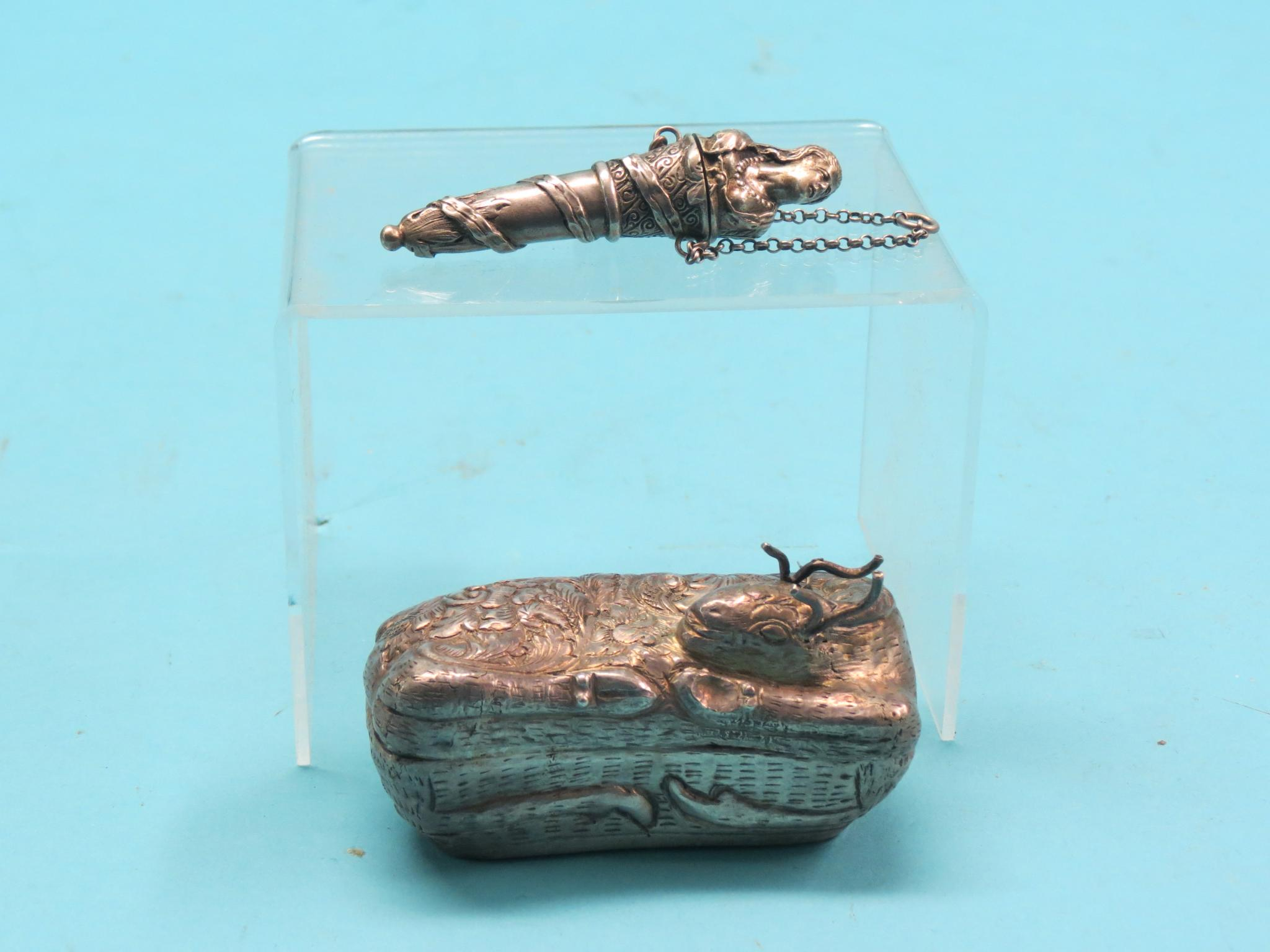 Lot 512 - A Cambodian .900 silver betel nut case, in the form of a recumbent deer, 3in., and a 19th century