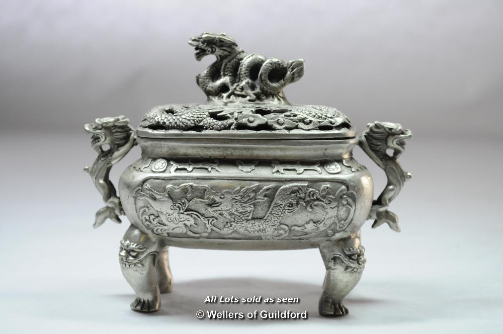 Lot 7092 - A Chinese rectangular white metal censor with dragon finial and handles, 13cm.