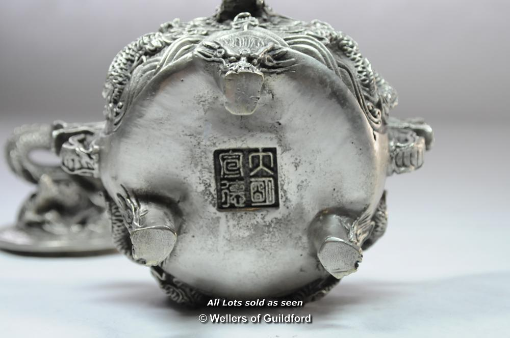 Lot 7093 - A Chinese circular white metal censor.