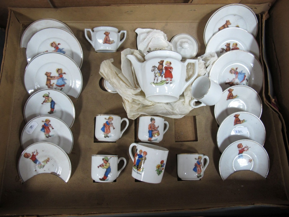Lot 54 - A XX Century Child's Transfer Tea Set, often with teddy bear subject, boxed, box poor.