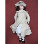 An Early XX Century Bisque Headed Doll, head stamped 14. Fixed eyes, open mouth with teeth, 73cm