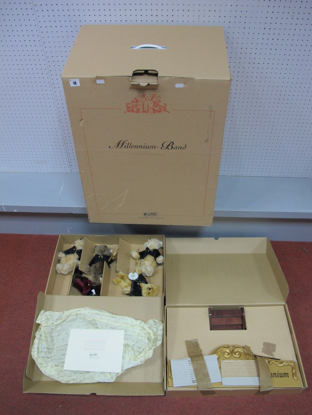 Lot 18 - A Boxed Steiff Teddy Bear Millennium Band Set, consisting of five Teddy Bears and a wooden stage