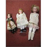 Three Early XX Century Bisque Headed Dolls, one stamped Germany, 370, 710M. With sleepy eyes, open