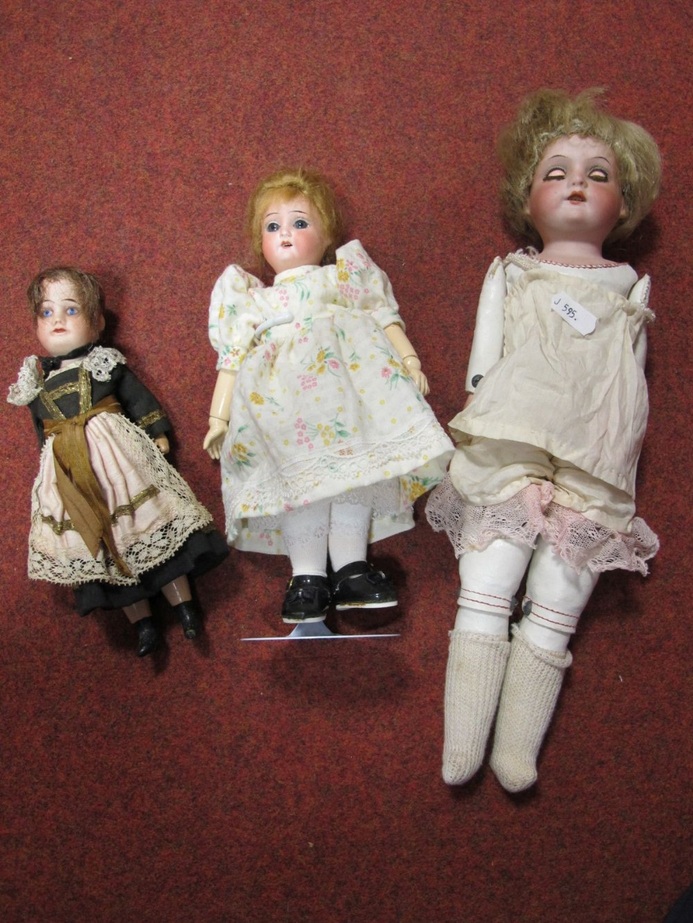 Lot 55 - Three Early XX Century Bisque Headed Dolls, one stamped Germany, 370, 710M. With sleepy eyes, open