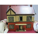A Mid XX Century Dolls House, single door opening, six rooms, frontage to house has six windows,