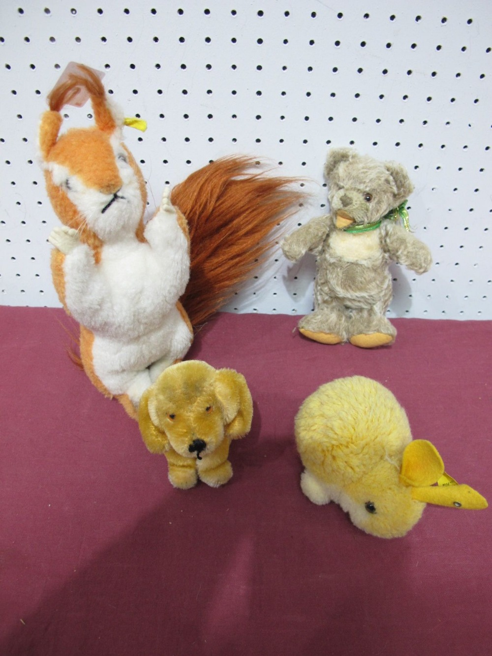 Lot 24 - Four Steiff Soft Toy Animals, 1960's and later, including growler bear, retriever puppy, baby