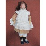 A Large Early XX Century Bisque Headed Doll, head stamped 191. Crack to back of head, sleepy eyes,