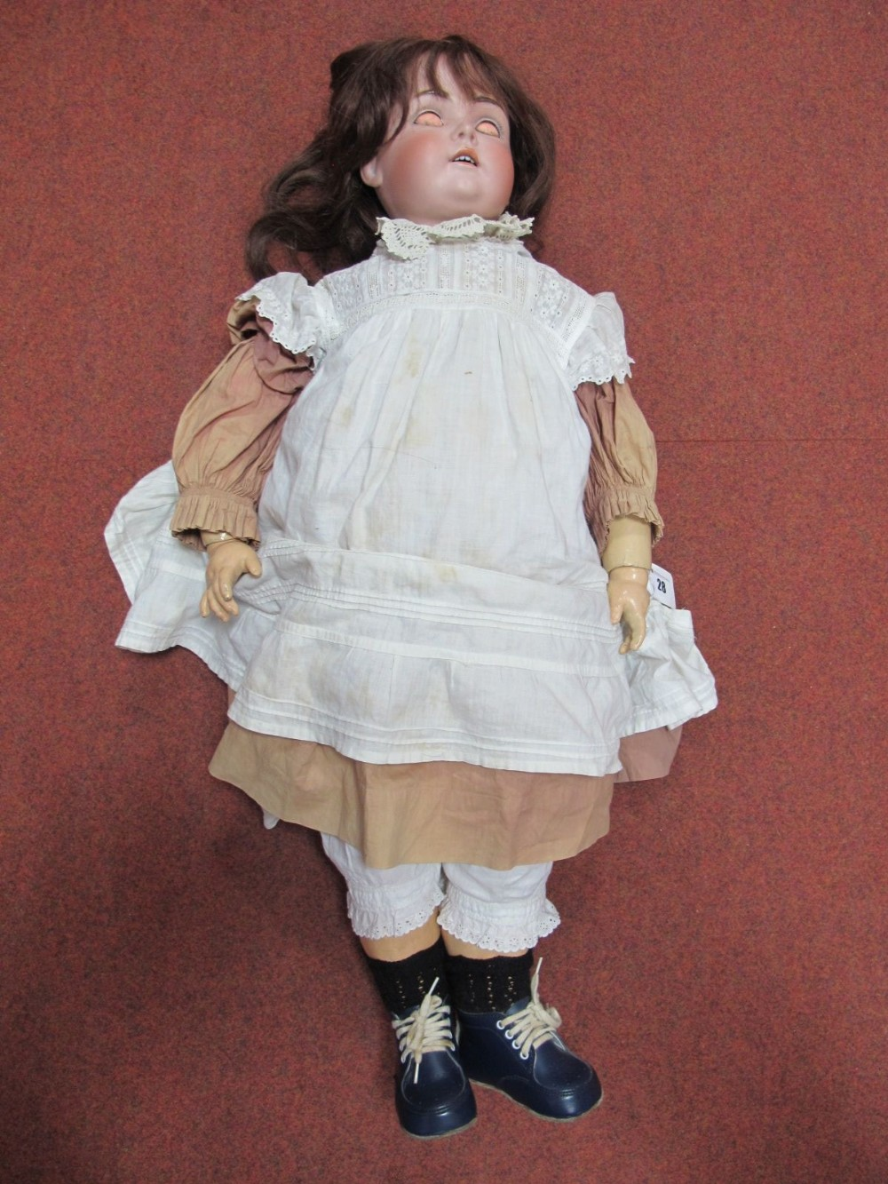 Lot 28 - A Large Early XX Century Bisque Headed Doll, head stamped 191. Crack to back of head, sleepy eyes,