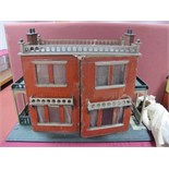 A Substantial Late XIX Century/Early XX Century Double Fronted Dolls House, in the form of a