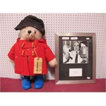 A Gabrielle Paddington Bear, circa 1980, red duffle coat, blue boots, brown felt hat, Darkest Peru