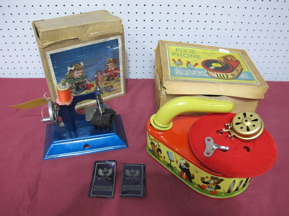 Lot 23 - A Mid XX Century Child's 'Pixie Phone', by Gama and a little Betty sewing machine, both boxed.