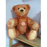 A Modern Steiff Classic Teddy Bear 'Sitting Down', red, with tags, 000218. Small hole noted on the