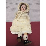 An Early XX Century Bisque Headed Doll by Armand Marseilles of Germany, head stamped 390/7½M. Sleepy