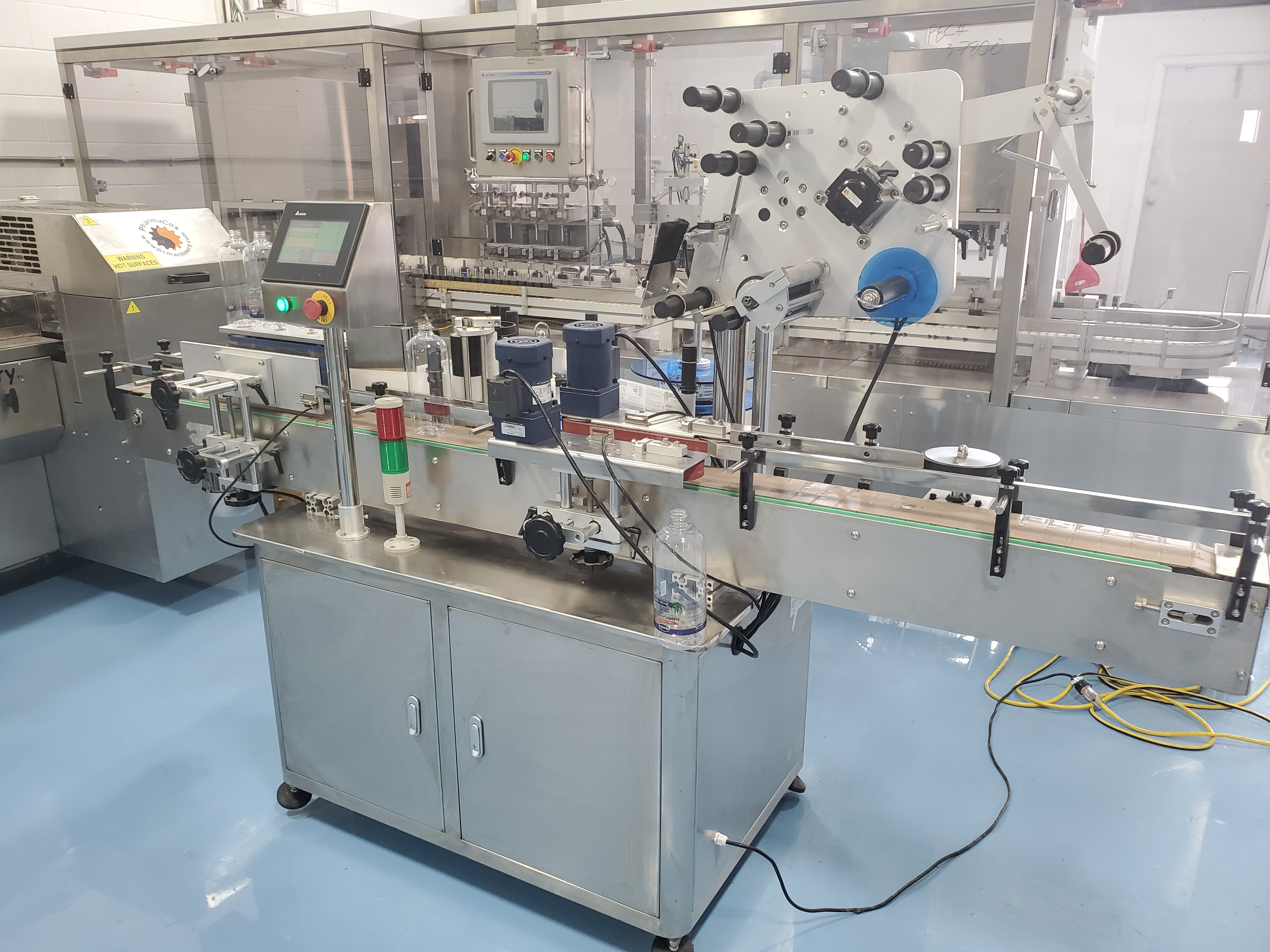 Grepack Packing Machine Integrated Wrap Around and Top Down Labeler with Conveyor