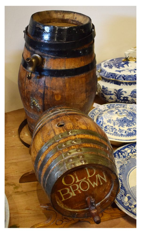 Lot 524 - Two metal-bound coopered oak barrels, one advertising 'Old Brown', the larger 44cm high (2)