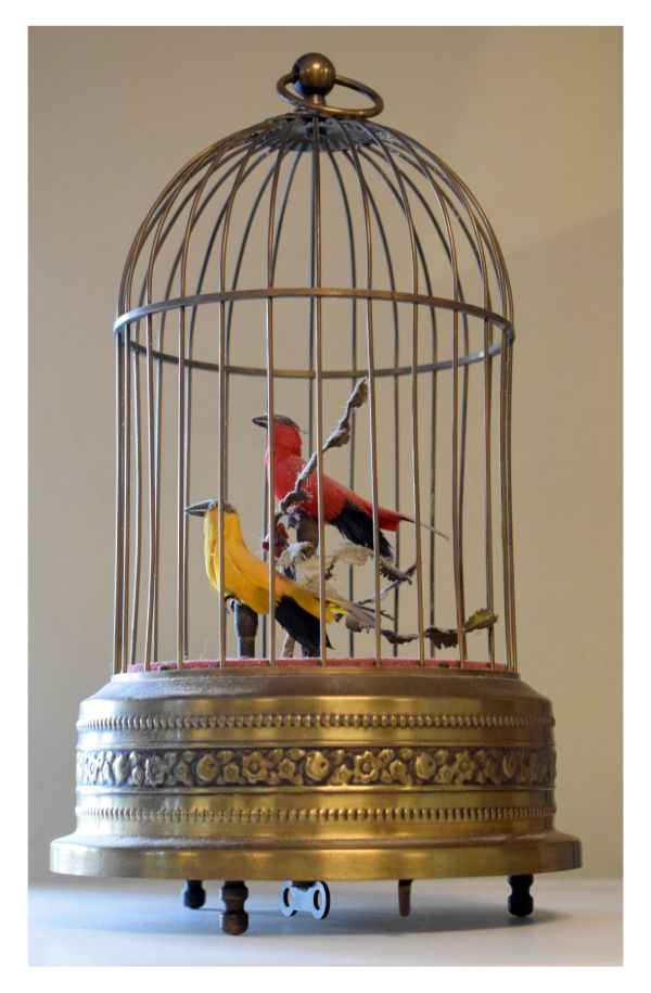 Lot 486 - Mid 20th Century Continental brass-cased singing bird musical automaton, modelled with two birds