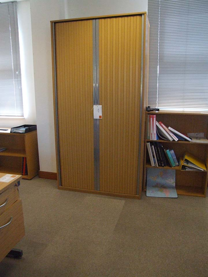 Lot 23 - Tambour front cupboard 2150 tall