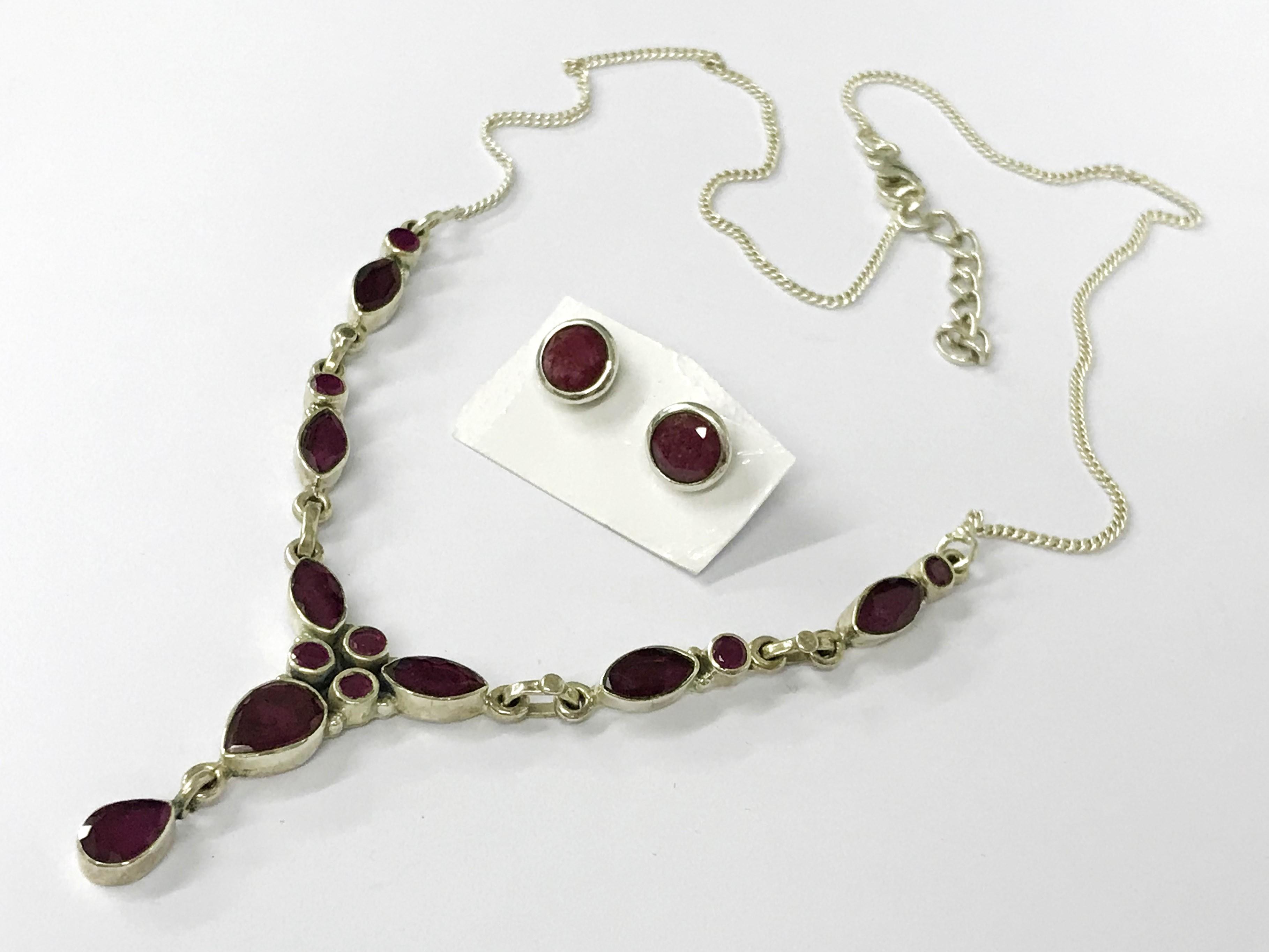 Lot 32 - Sterling silver raw ruby set necklace earrings
