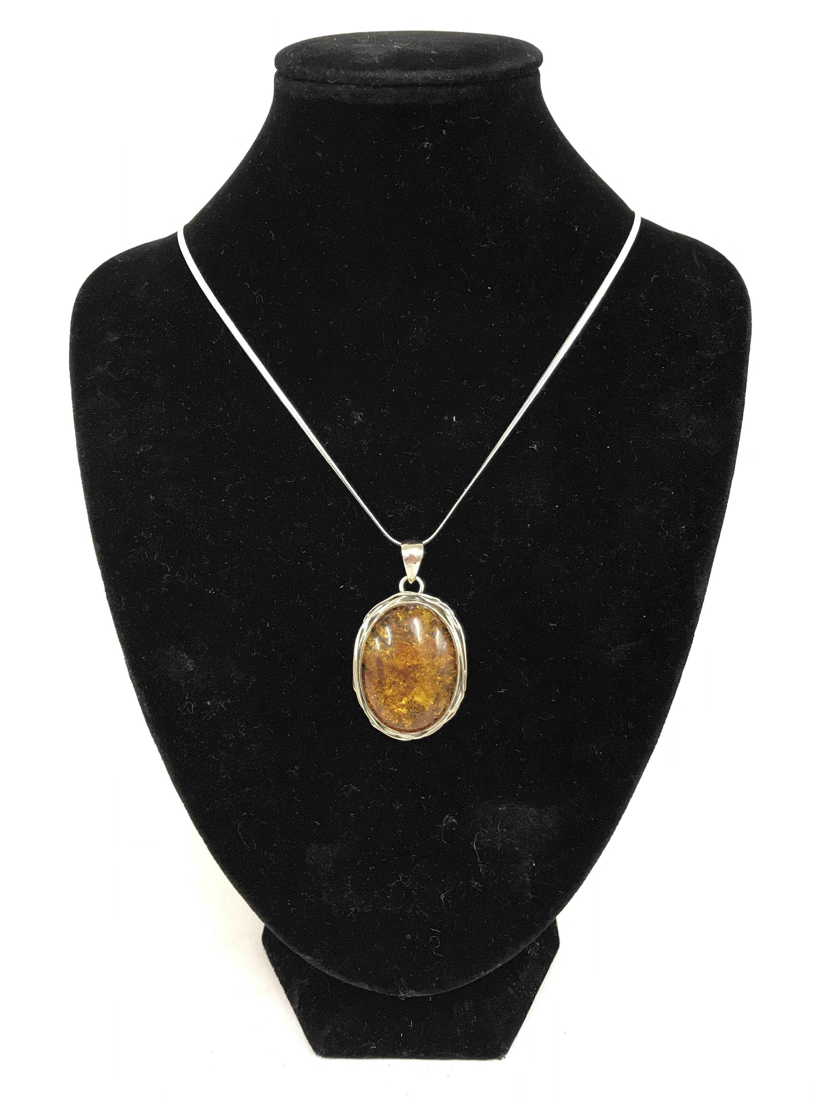 Lot 43 - Sterling silver Baltic amber pendent