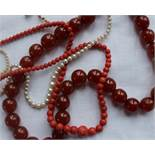 A coral bead necklace with graduated beads approximately 23 grams together with a pearl necklace