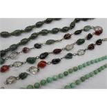 A jade bead necklace together with a hardstone graduated bead necklace,