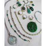 A collection of silver jewellery, gem set with green stones including rings, pendants,