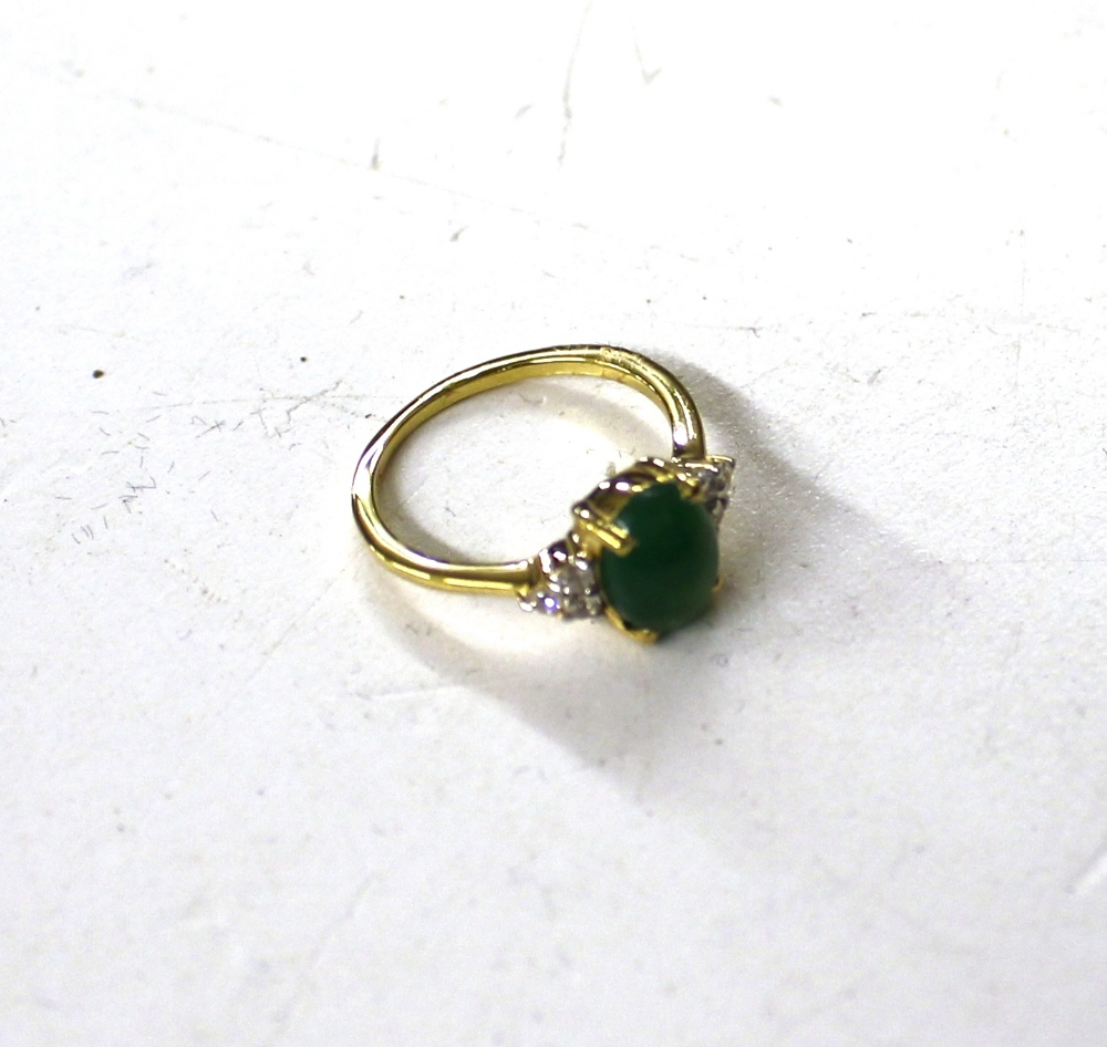 Lot 127 - A Sterling silver and 14ct gold overlaid green jad