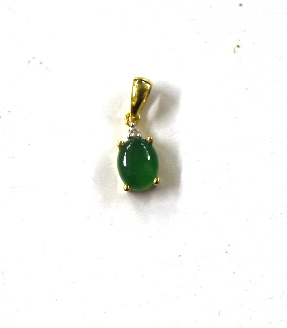 Lot 128 - A Sterling silver and 14ct gold overlaid green jad