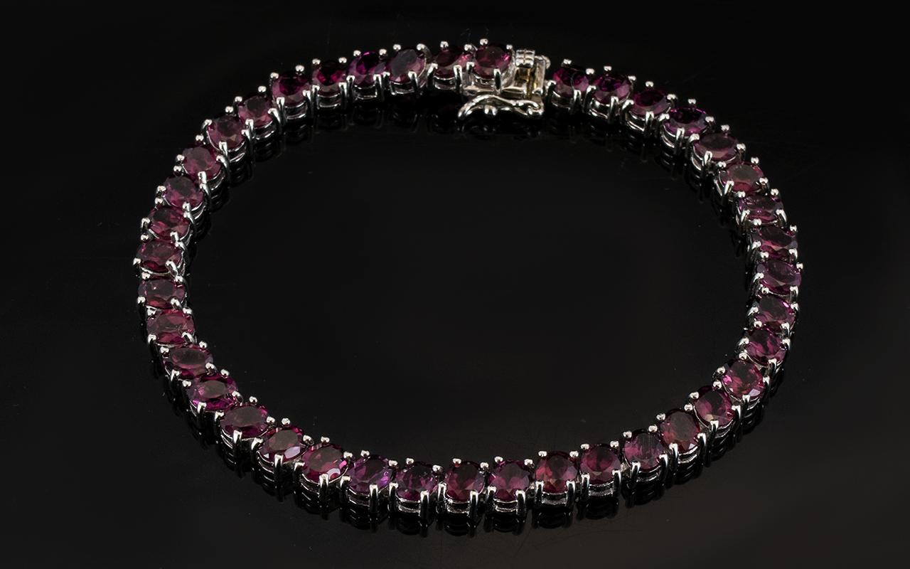 Lot 175 - Garnet Tennis Bracelet, oval cuts of the