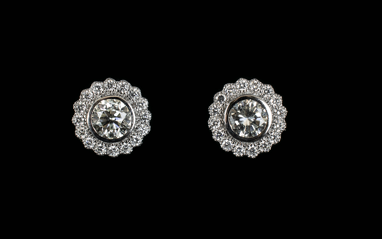 Lot 2 - A Pair Of 18ct White Gold And Diamond Se