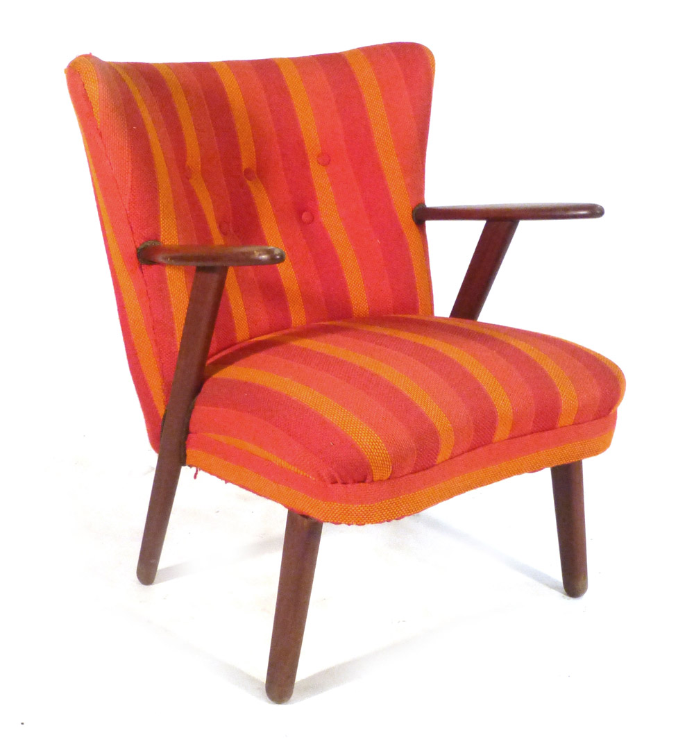 A 1940's teak framed and button upholstered lounge chair