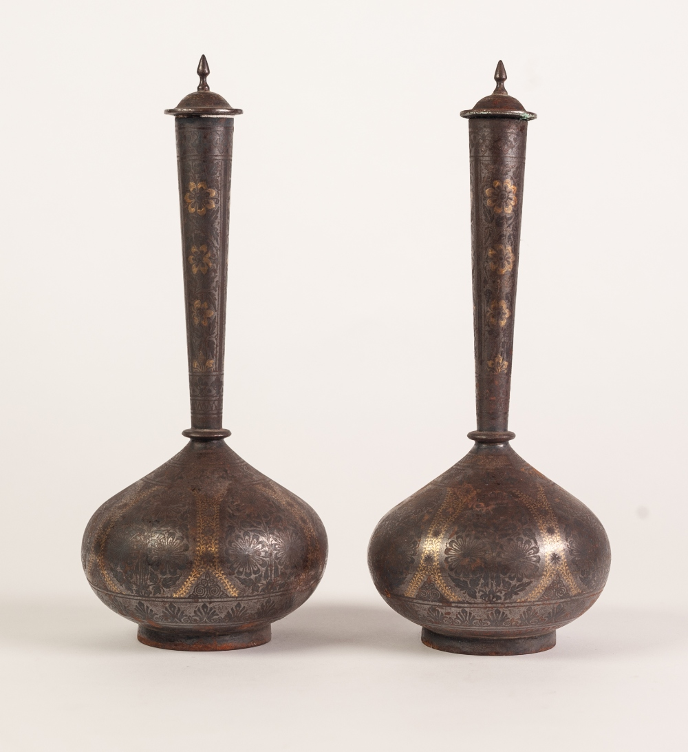 Lot 131 - PAIR OF MIDDLE EASTERN GOLD INLAID WHITE METAL VASES AND COVERS, each of globe and shaft form with