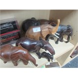 Lot 41 - 6 Carved wood elephants