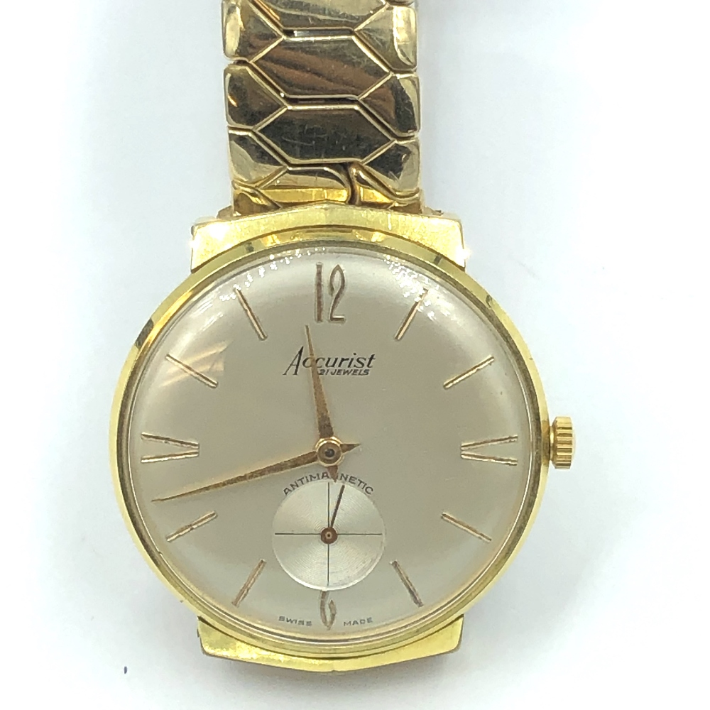 Lot 35 - Gentlemans accurist automatic yellow metal wristwatch, cream face with Roman interval baton